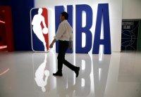 Китайская компания ANTA приостановила контрактные переговоры с НБА